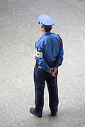 Tokyo police officer seen from behind