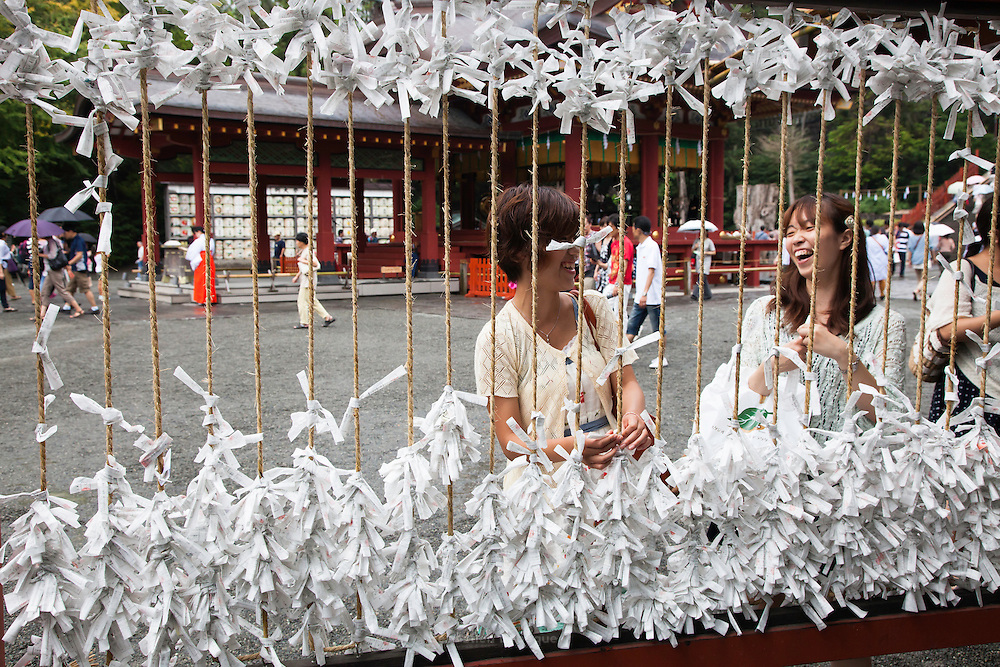KAMAKURA, JAPAN, 16 SEPTEMBER - Two women are laughing when the attach the omikoshi that suppose to tell your fortune for one year. Tsurugaoka Hachimangu  the most important temple of Kamakurawas founded 1063 and inlarge by Minato Yorimoto, the first Shogun of Kamakura period - september 2012