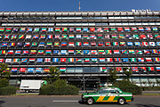 A Japanese taxi  in front of the Offices of the Mainichi Newspaper Company display all 206 flags of the countries taking part in the 2020 Tokyo Olympic Games. Chiyoda, Tokyo, Japan. Friday October 27th 2017. Saturday October 28th marks 1,000 days before the opening ceremony of the Summer Olympics in Tokyo. Each flag is 210 centimeters wide and 140 centimeters high and is being draped over windows on the south side of the building, facing the Imperial Palace