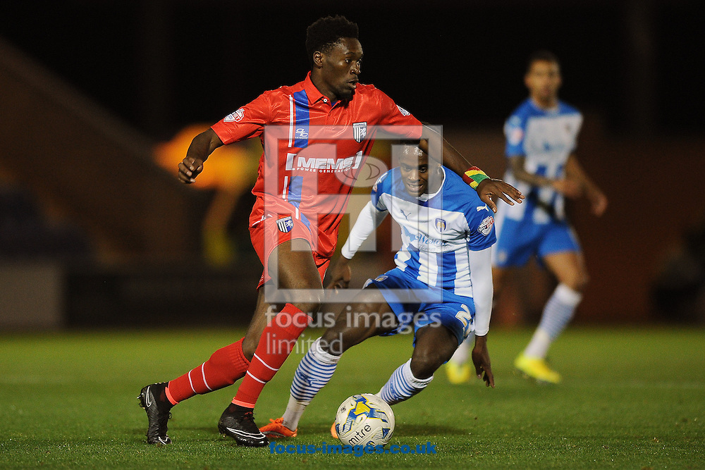 Amine Linganzi of Gillingham does battle with Gavin Massey of Colchester United during the Johnstone's Paint Trophy match between Colchester United and Gillingham at the Weston Homes Community Stadium, Colchester<br /> Picture by Richard Blaxall/Focus Images Ltd +44 7853 364624<br /> 07/10/2014