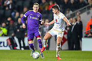 Portsmouth midfielder Ronan Curtis (11) goes past Milton Keynes Dons midfielder Jordan Houghton (24) during the EFL Sky Bet League 1 match between Milton Keynes Dons and Portsmouth at Stadium MK, Milton Keynes, England on 29 December 2019.