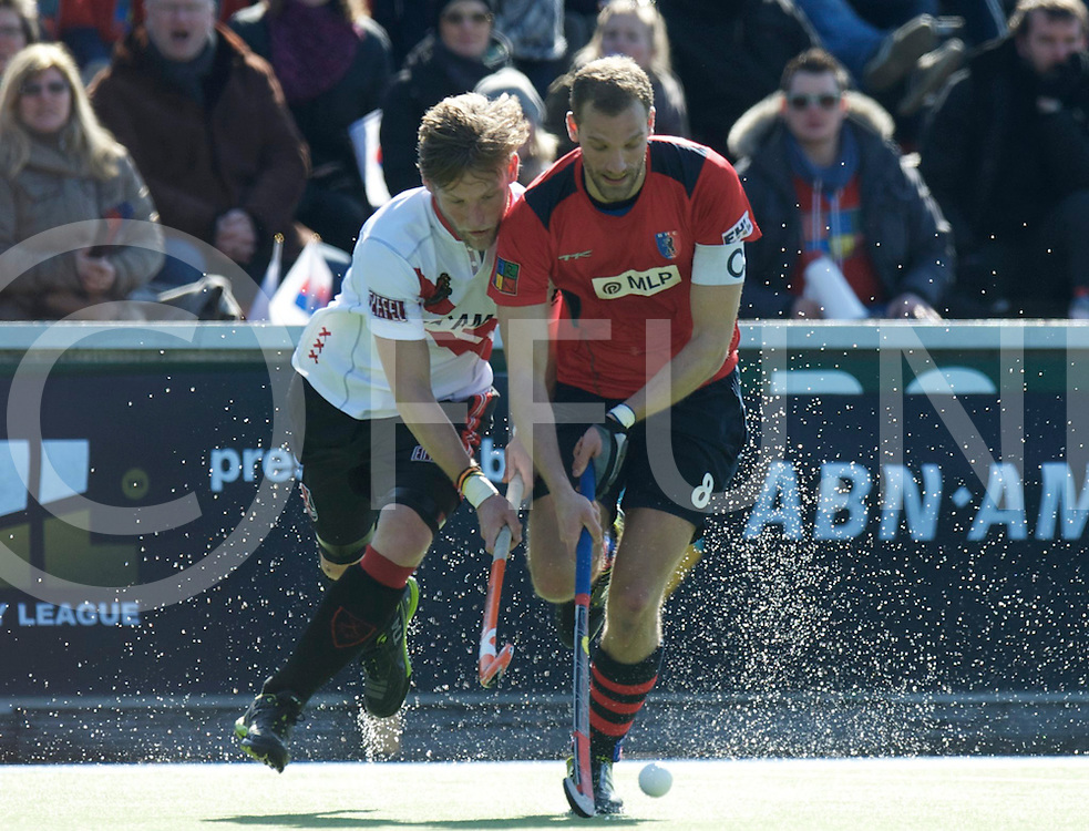 Amstelveen - Euro Hockey league KO16.Amsterdamse H&BC - Berliner HC.foto: Robert Tigges (white) and Richard Braun (red)..FFU PRESS AGENCY COPYRIGHT FRANK UIJLENBROEK.