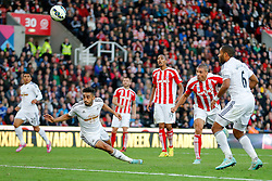 Jonathan Walters of Stoke City heads the ball past Neil Taylor of Swansea City and scores a goal to make it 2-1 - Photo mandatory by-line: Rogan Thomson/JMP - 07966 386802 - 19/10/2014 - SPORT - FOOTBALL - Stoke-on-Trent, England - Britannia Stadium - Stoke City v Swansea City - Barclays Premier League.