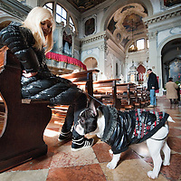 VENICE, ITALY - JANUARY 15:  A woman and her dog attend a special service with a blessiing of  pets and animals held by Don Filippo Chiafoni Chaplain of the Church of S Francesco da Paola on January 15, 2012 in Venice, Italy. The blessing of animals and pets is a very ancient tradition dating back from San Francis of Assisi.