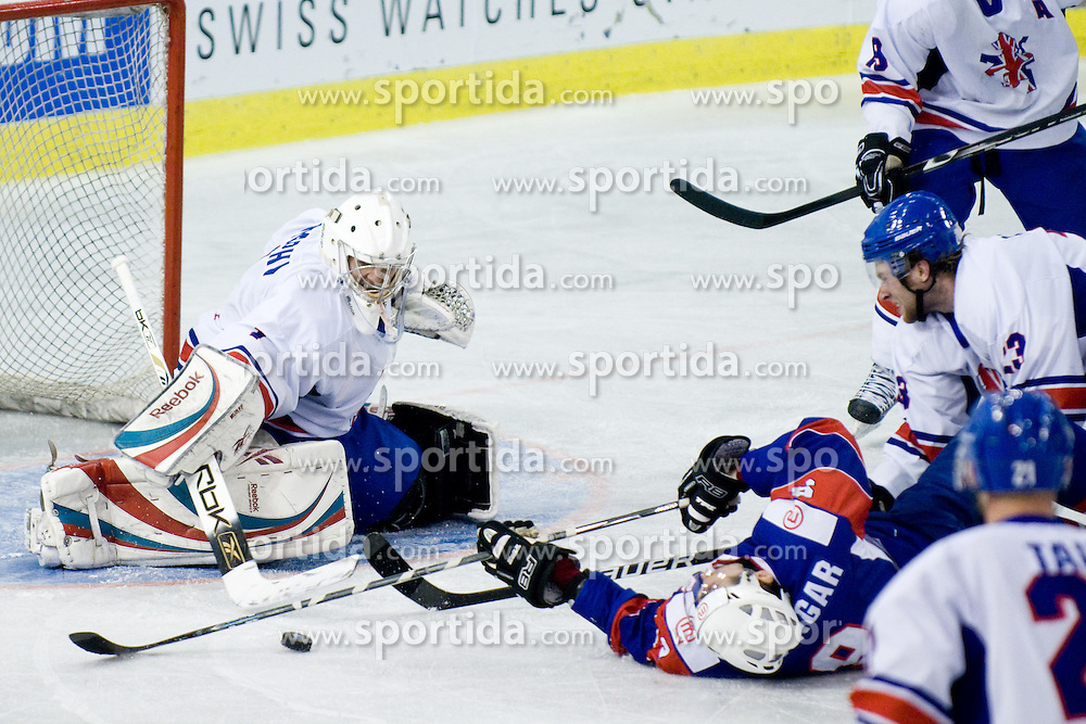 Tomaz Razingar of Slovenia vs Steven Murphy of Great Britain at IIHF Ice-hockey World Championships Division I Group B match between National teams of Slovenia and Great Britain, on April 20, 2010, in Tivoli hall, Ljubljana, Slovenia. Slovenian defeated Great Britain 3:2 OT. (Photo by Matic Klansek Velej / Sportida)