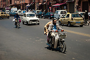 Marrakech traffic; lots of mopeds, motorcycles and...