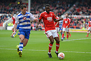 Nottingham Forest midfielder Mustafa Carayol (18) Reading striker Yann Kermorgant (18) during the EFL Sky Bet Championship match between Nottingham Forest and Reading at the City Ground, Nottingham, England on 22 April 2017. Photo by Jon Hobley.