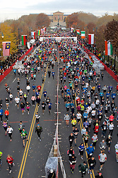 19th Philadelphia Marathon. November 18, 2012 - Benjamin Franklin Parkway, Philadelphia, PA; Starting in starting waves a total of 30.000 runners make their way down the Parkway to head into the first Center City part of the route. (Photo shot from a scissor lift across the start/finish line)..McKeeman is the 2012 men's Philadelphia Marathon winner clocking in at 2:17:47. Mashkantceva broke the women's Philadelphia Marathon record at 2:35:34...