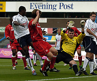 Photo. Jed Wee.<br /> Preston North End v Middlesbrough, Preseason Friendly, 24/07/2004.<br /> Preston goalkeeper Andy Lonergan spreads himself to save from Middlesbrough's Malcolm Christie<br /> NORWAY ONLY