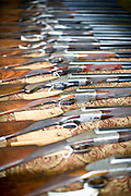 A display of shotguns at Side by Side in Sanford, NC.