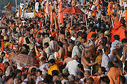 Nagas (Hindu ascetics who are followers of Sadhus) congregate to bathe in the Shipra River during the Kumbh Mela festival, Ujjain, Madhya Pradesh, India. The Kumbh Mela festival is a sacred Hindu pilgrimage held 4 times every 12 years, cycling between the cities of Allahabad, Nasik, Ujjain and Hardiwar.  Participants of the Mela gather to cleanse themselves spiritually by bathing in the waters of India's sacred rivers.  Kumbh Mela is one of the largest religious festivals on earth, attracting millions from all over India and the world.  Past Melas have attracted up to 70 million visitors..