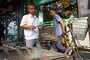 Old Beijing Bike Culture, a man sharpens knives with a portable bicycle-based workstation  in the trendy Gulou district-- 2011 Tour of Beijing Scouting Photos