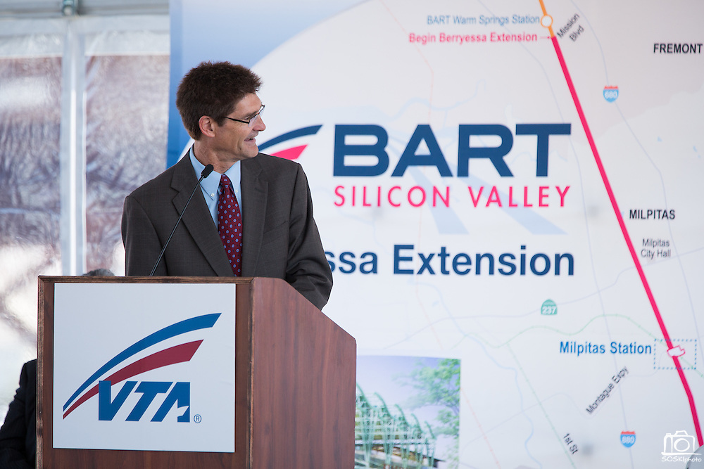 Silicon Valley Leadership Group CEO Carl Guardino looks at a map of the BART Silicon Valley Extension during VTA's BART Silicon Valley Extension Celebration in San Jose, California, on August 20, 2014. (Stan Olszewski/SOSKIphoto)