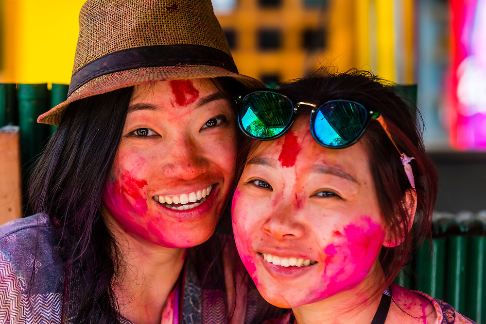 Young Chinese tourists at Holi Festival, Mathura, Uttar Pradesh, India.