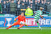 Scott Sinclair(#11) of Celtic FC scores a penalty against Zdenek Zlamal (#1) of Heart of Midlothian during the Betfred League Cup semi-final match between Heart of Midlothian FC and Celtic FC at the BT Murrayfield Stadium, Edinburgh, Scotland on 28 October 2018.