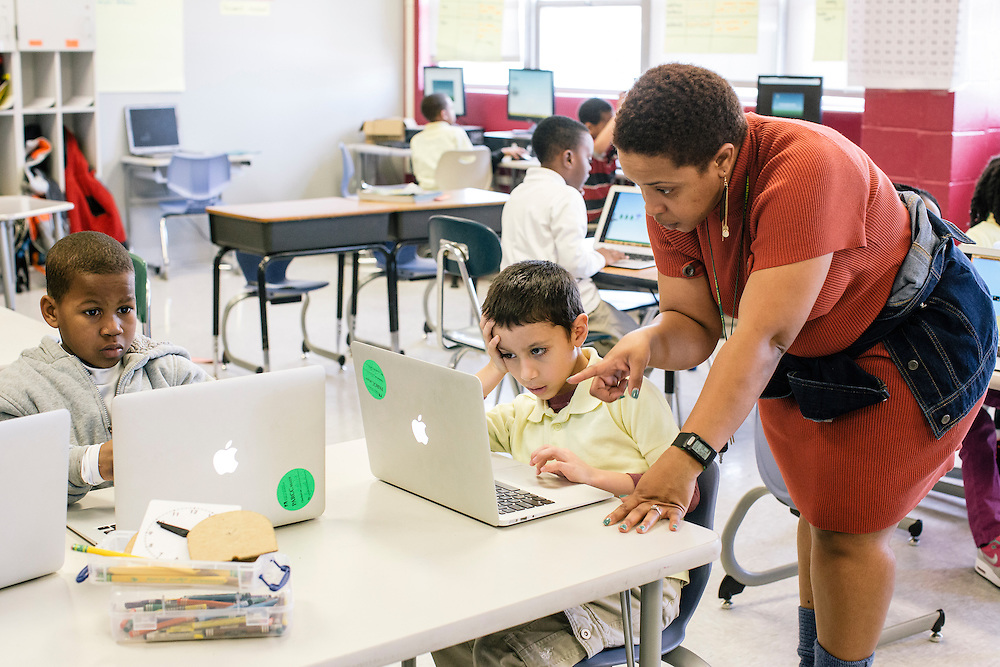Kristee Jones, a first-grade math teacher, works with students including children like Diego Muñoz-Nunez, who have parents in the military, at Leckie Elementary School in SW Washington, D.C. Nearly a third of the school is attended by the children of military families.