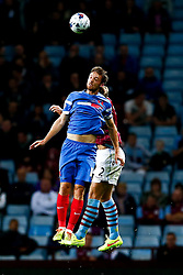 David Mooney of Leyton Orient and Nathan Baker of Aston Villa compete in the air - Photo mandatory by-line: Rogan Thomson/JMP - 07966 386802 - 27/08/2014 - SPORT - FOOTBALL - Villa Park, Birmingham - Aston Villa v Leyton Orient - Capital One Cup Round 2.