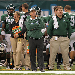 Sep 12, 2009; New Orleans, LA, USA; Tulane Green Wave head coach Bob Toledo (center) on the sideline against the BYU Cougars during the first quarter at the Louisiana Superdome.  Mandatory Credit: Derick E. Hingle-US PRESSWIRE
