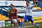 Bradford City Defender, Anthony McMahon and Bury Defender, Chris Hussey battle for the ball during the Sky Bet League 1 match between Bury and Bradford City at the JD Stadium, Bury, England on 5 March 2016. Photo by Mark Pollitt.