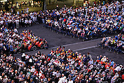 crowd during holy mass after the candle parade at the basilica of the immaculate conception Notre Dame of Lourdes in France