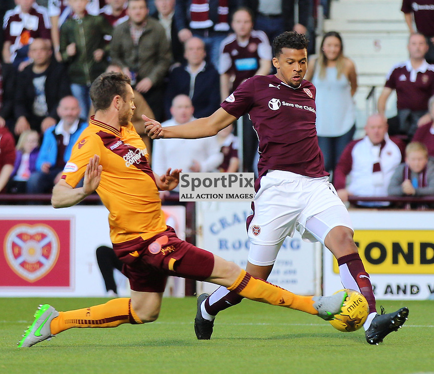 Hearts v Motherwell Scottish Premiership 12 August 2015; Osman Sow (Hearts, 10) has his shot blocked by Stephen McManus (Motherwell, 6) during the Heart of Midlothian v Motherwell Scottish Premiership match played at Tynecastle Stadium, Edinburgh; <br /> <br /> &copy; Chris McCluskie | SportPix.org.uk