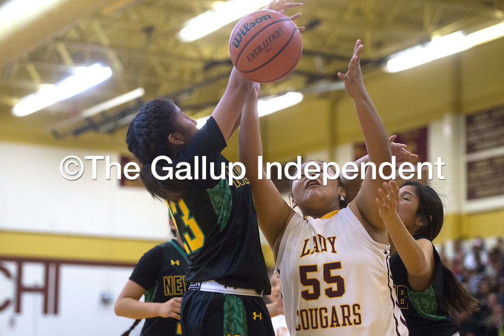 Tohatchi Cougar Sarah Begay (55) jumps to grab possession of a rebound Friday at the district game in Tohatchi.