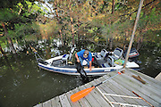 "8/11/11} Vicksburg} -- Vicksburg, MS, U.S.A. -- Mark Bridges,56, thrift store owner, pulls his dog ""baby girl"" back into the boat after the dog jumped in thinking hshe was being left at the house when Mark was turning the boat around. Mark and his girlfriend of 12 years Patricia Clark, a HomeDepot garden employee, cruise down Chicksaw Rd in a bass boat in North Kings Community in Vicksburg Mississippi Wed. May 5th 2011. This is the firs time for Patricia to try and remove things from her trailer, that is built on 9ft stilts  AND THE WATER IS CURRENTLY AT 15 ft. and rising and is less than 12 inches from being flooded. Mark and Patricia have lived their all their lives and will return when the Mississippi River recedes,. ark has been helping his neighbors get their belongings to safety. Vicksburg a riverfront town steeped in war and sacrifice, gets set to battle an age-old companion: the Mississippi River. The city that fell to Ulysses S. Grant and the Union Army after a painful siege in 1863 is marshalling a modern flood-control arsenal to keep the swollen Mississippi from overwhelming its defenses. PHOTO©SUZIALTMAN.COM.Photo by Suzi Altman, Freelance."