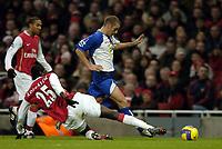 Photo: Olly Greenwood.<br />Arsenal v Blackburn Rovers. The Barclays Premiership. 23/12/2006. Arsenal's Emmanuel Adebayor tackles Blackburn's David Bentley