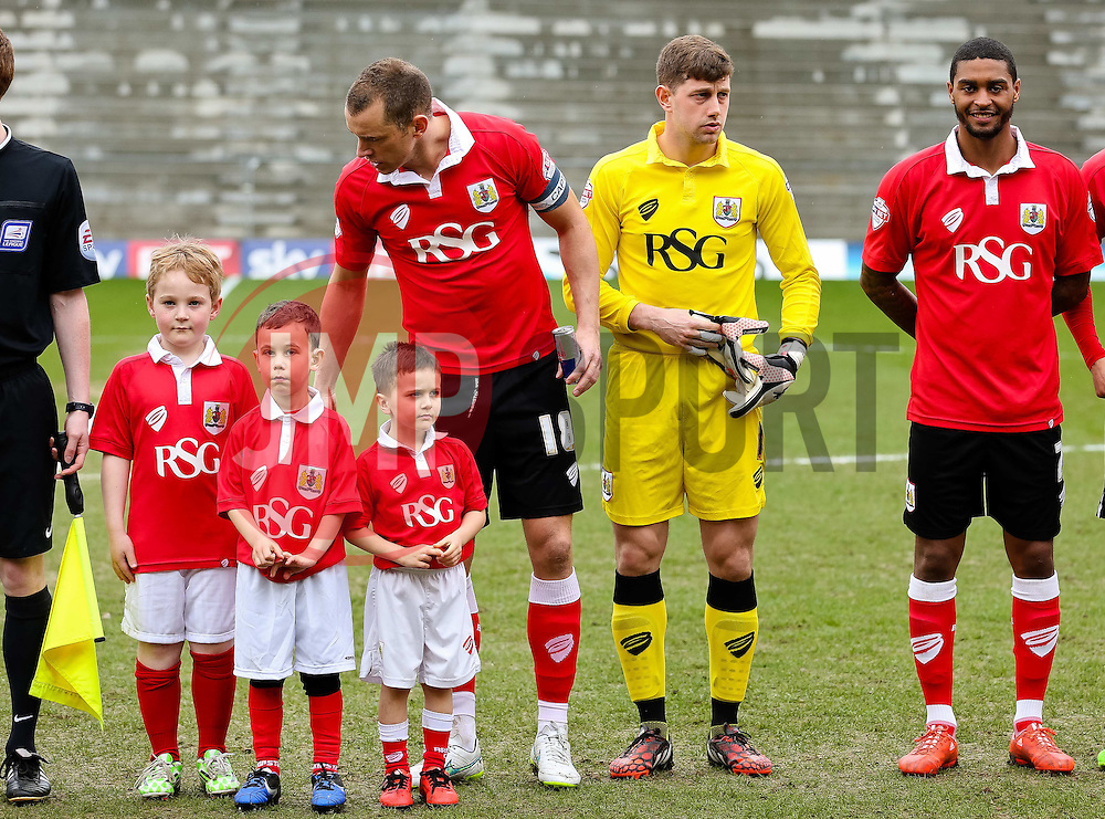 Bristol City's Aaron Wilbraham with 3 young mascots - Photo mandatory by-line: Matt McNulty/JMP - Mobile: 07966 386802 - 03/04/2015 - SPORT - Football - Oldham - Boundary Park - Oldham Athletic v Bristol City - Sky Bet League One