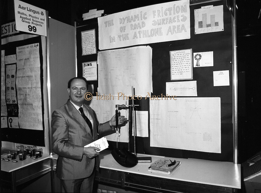 08/01/1988.01/08/1988.8th January 1988 .The Aer Lingus Young Scientist of the Year Award at the RDS, Dublin ..Picture shows Con Power, Director of Economic Policy Confederation of Irish Industry looking at the project 'Study of Road Surfaces in Athlone' entered by Naomi Magliocco and Paula Starken from Our Lady's Bower School, Athlone, Co. Westmeath, one of the entries which won a prize sponsored by the CII.