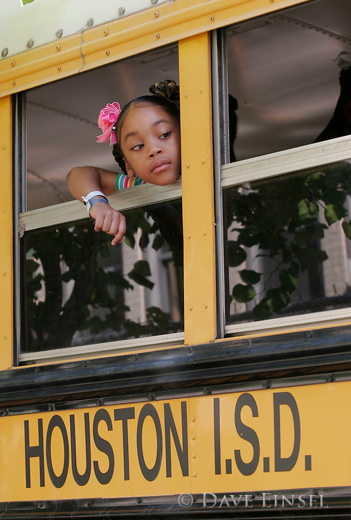 HOUSTON - SEPTEMBER 8:  An evacuee student peeks out of his bus as he arrives at Douglass Elementary School in Houston Thursday, September 8, 2005. About 175 students are registered at Douglass which was closed for budgetary reasons but the HISD reopened the facility for children of evacuees from Hurricane Katrina.<br />