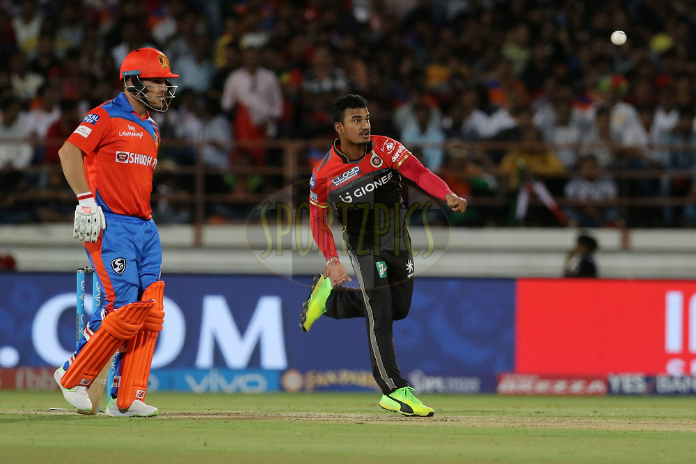 Pawan Negi of the Royal Challengers Bangalore bowls during match 20 of the Vivo 2017 Indian Premier League between the Gujarat Lions and the Royal Challengers Bangalore  held at the Saurashtra Cricket Association Stadium in Rajkot, India on the 18th April 2017<br /> <br /> Photo by Vipin Pawar - Sportzpics - IPL