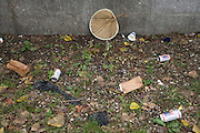 beer cans and other trash trown on the ground