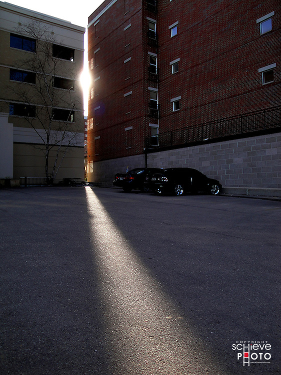 The setting sun peeks between two buildings in Madison, Wisconsin.