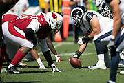 The Los Angeles Rams offensive line gets set to snap the ball opposite the Arizona Cardinals defensive line at the line of scrimmage during the 2018 NFL regular season week 2 football game against the Arizona Cardinals on Sunday, Sept. 16, 2018 in Los Angeles. The Rams won the game in a 34-0 shutout. (©Paul Anthony Spinelli)