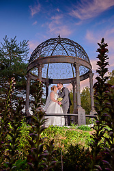 Romantic photograph of the happy couple captured in the Cast Iron Wedding Gazebo at Shortmead House.
