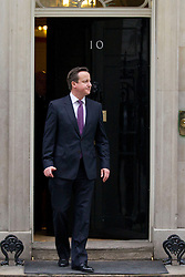 © Licensed to London News Pictures. 12/02/2013. London, UK. The British Prime Minister, David Cameron waits for his Pakistani counterpart, Prime Minister Raja Pervaiz Ashraf on Downing Street in London today (12/02/2013). Photo credit: Matt Cetti-Roberts/LNP