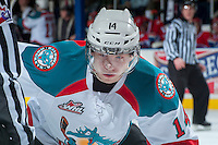 KELOWNA, CANADA -JANUARY 29: Rourke Chartier #14 of the Kelowna Rockets faces off against the Spokane Chiefs on January 29, 2014 at Prospera Place in Kelowna, British Columbia, Canada.   (Photo by Marissa Baecker/Getty Images)  *** Local Caption *** Rourke Chartier;