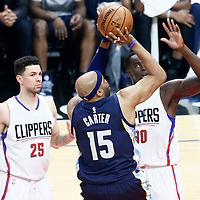 04 January 2017: Memphis Grizzlies guard Vince Carter (15) takes a jump shot over LA Clippers guard Austin Rivers (25) and LA Clippers forward Brandon Bass (30) during the LA Clippers 115-106 victory over the Memphis Grizzlies, at the Staples Center, Los Angeles, California, USA.
