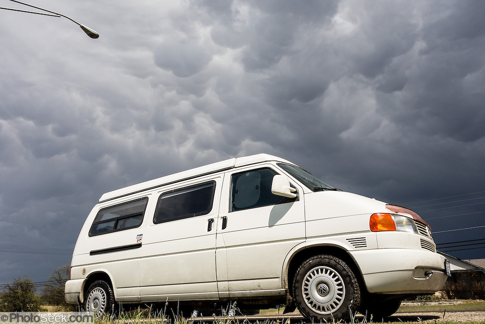Localized downdrafts form mammatus under a cumulonimbus cloud near Austin, Texas, USA. Mammatus (from the Latin root mamma, meaning breast) is a cellular pattern of bubble-like pouches hanging beneath the base of a cloud. A Volkswagon Eurovan Camper makes a great economical RV for two people.