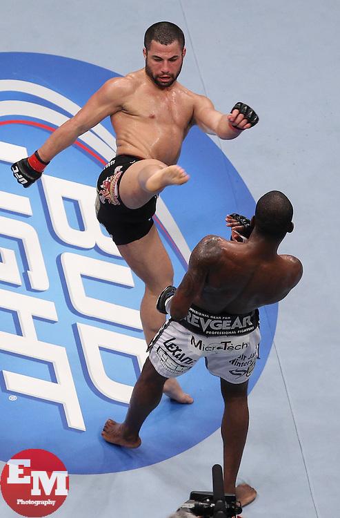 Atlanta, GA - April 21, 2012: John Makdessi (black trunks) and Anthony Njokuani (white trunks) during UFC 145 at the Phillips Arena in Atlanta, Georgia.
