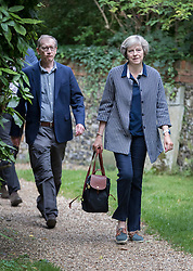 © Licensed to London News Pictures. 28/08/2016. Reading, UK. Prime Minister Theresa May and her husband Philip attend church in her constituency. Photo credit: Peter Macdiarmid/LNP