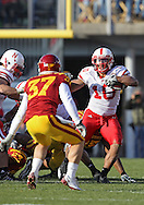 November 06 2010: Nebraska Cornhuskers running back Roy Helu Jr. (10) tries to avoid Iowa State Cyclones cornerback Michael O'Connell (37) during the first half of the NCAA football game between the Nebraska Cornhuskers and the Iowa State Cyclones at Jack Trice Stadium in Ames, Iowa on Saturday November 6, 2010. Nebraska defeated Iowa State 31-30.