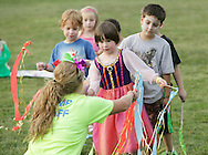 Middletown, New York - A counselor helps children from the Middletown YMCA summer camp get ready to perform during a talent show for parents and other campers on August 17, 2010.
