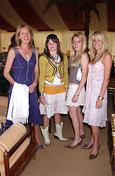 Left to right, VISCOUNTESS COWDRAY and her daughters the HON.CATRINA PEARSON, the HON.EMILY PEARSON and the HON.ELIZA PEARSON at the Veuve Clicquot sponsored Gold Cup Final or the British Open Polo Championship held at Cowdray Park, West Sussex on 17th July 2005.<br />