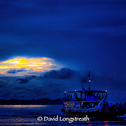 "In this ""Signature Series"" image by David Longstreath a ferry boat crosses the Mekong River near Phnom Penh, Cambodia."