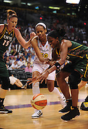 Sep 5, 2010; Phoenix, AZ, USA; Phoenix Mercury forward Tangela Smith (50) fights for a lose ball with Seattle Storm forward Swin Cash (2) and forward Lauren Jackson (15) during the first half in game two of the western conference finals in the 2010 WNBA Playoffs at US Airways Center.  The Storm defeated the Mercury 91-88.  Mandatory Credit: Jennifer Stewart-US PRESSWIRE