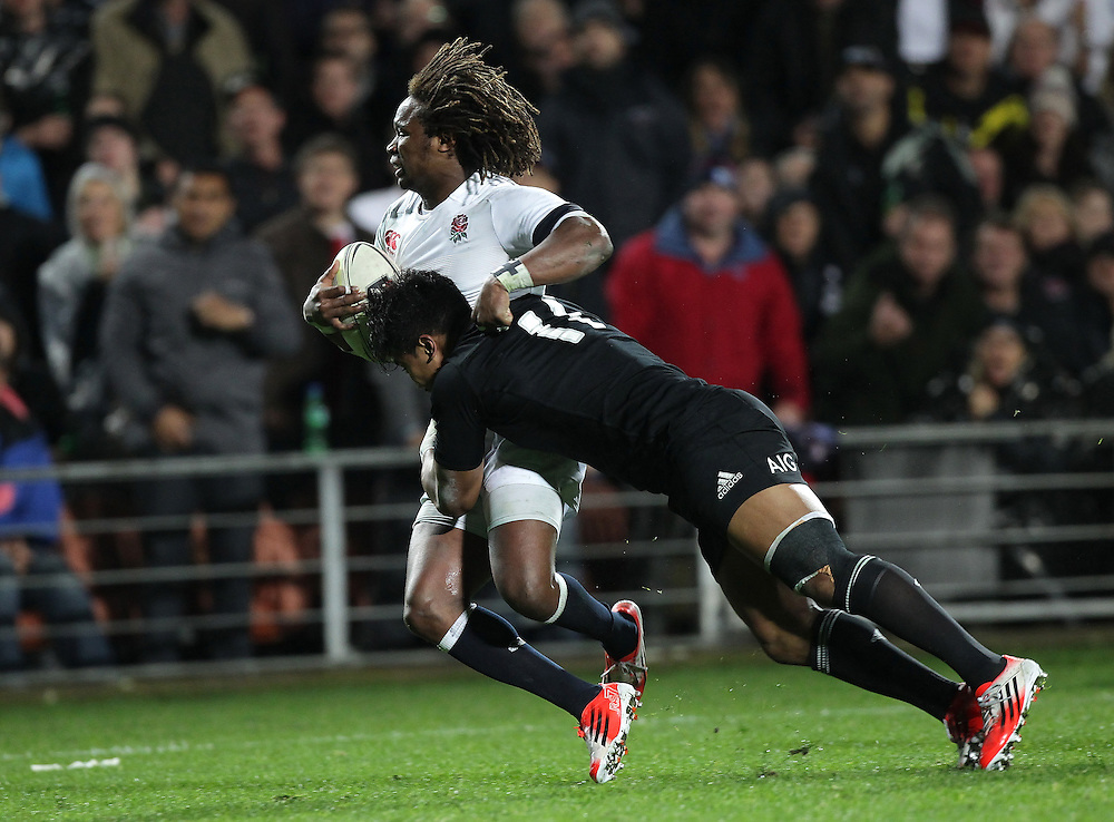 New Zealand's Julian Savea tackles England's Marland Yarde in an International Rugby Test match, Waikato Stadium, Hamilton, New Zealand, Saturday, June 21, 2014.  Credit:SNPA / David Rowland