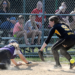 Staff photos by Tom Kelly IV<br /> Upper Darby's Alex Turchi (10) dives safely back to third base under the tag of Interboro shortstop Miranda Baylor (9) during the Interboro at Upper Darby girls softball game, Friday afternoon.
