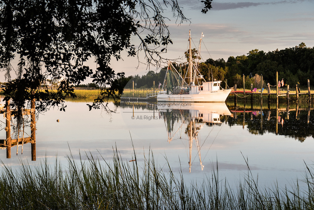Shrimp boats along Jeremy Creek in the village of McClellanville, South Carolina.